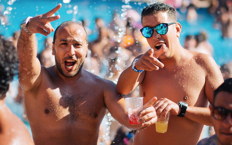 Two men at a pool party in Magaluf