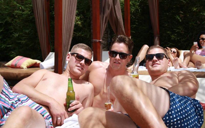Some men at a beach bar in Marbella
