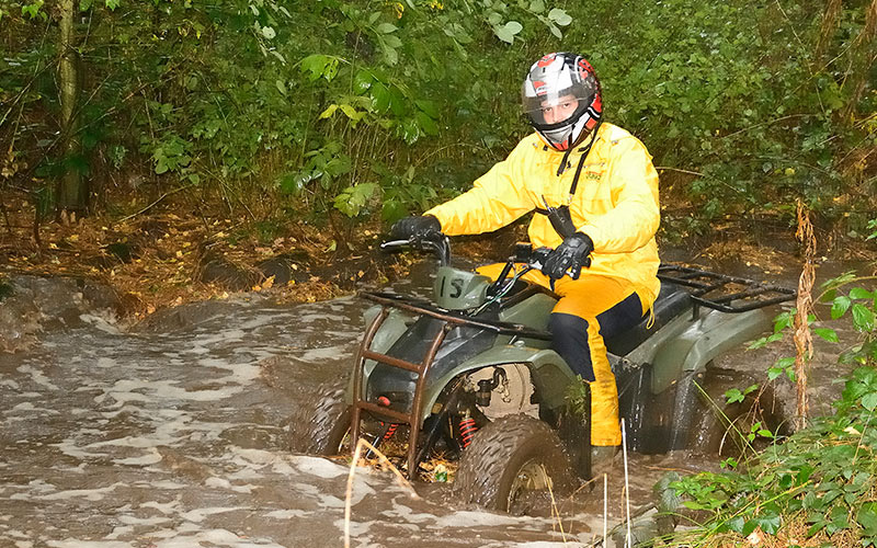 A man on a quad bike in the mud