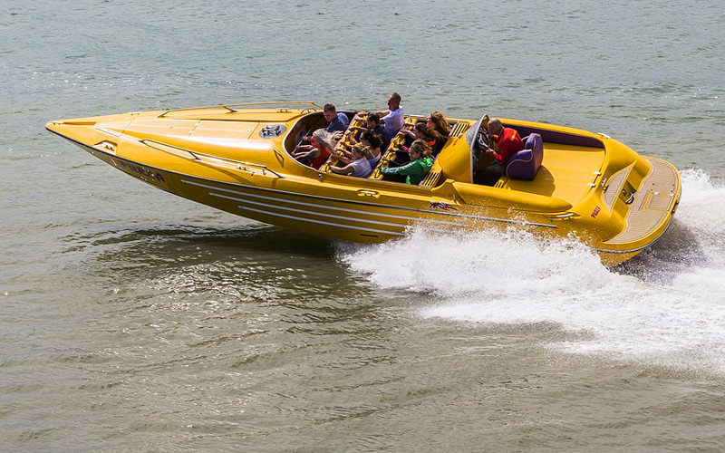 A group of people in a speedboat