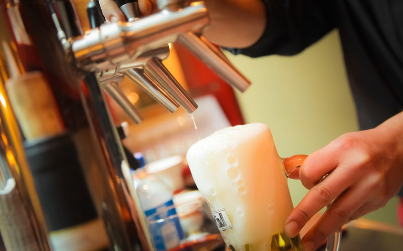 A close up of a pint being poured