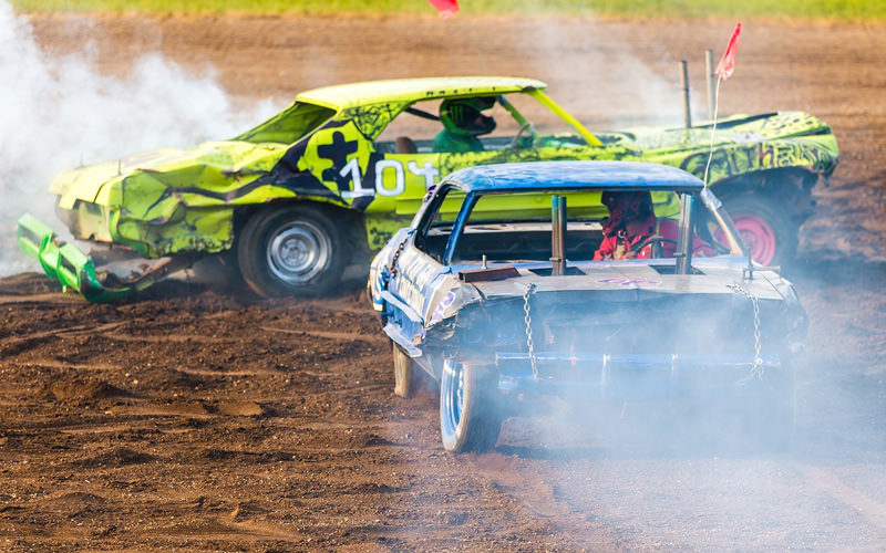 Two vehicles on a dirt track