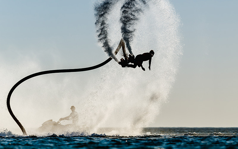 A man on a flyboard above the sea
