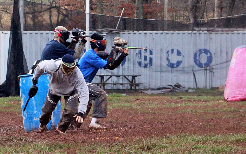 A group of people carrying paintball guns