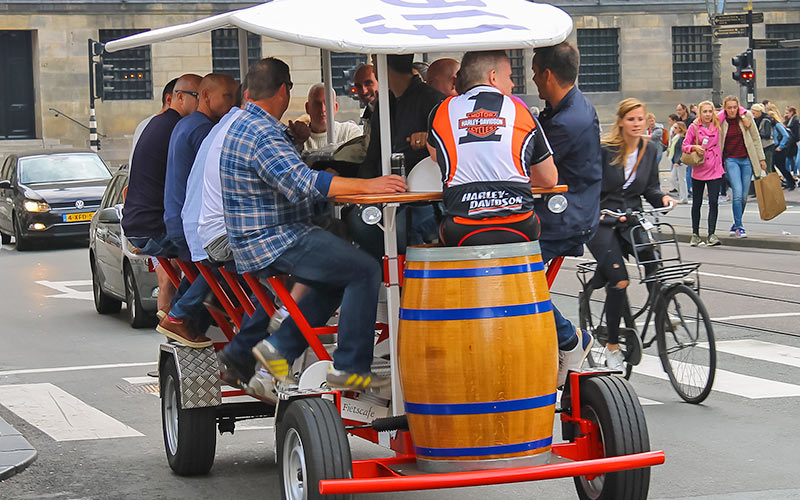 A group of men on a beer bike