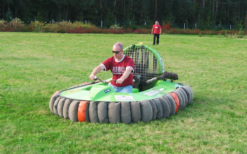 A man riding an inflatable vehicle