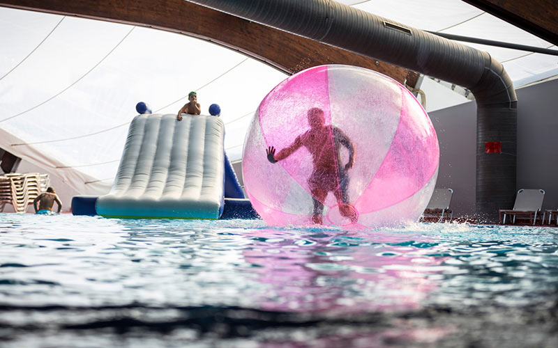 Someone in an inflatable zorb on the water