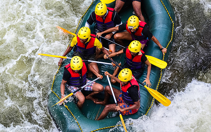 An aerial view of a group of people white water rafting