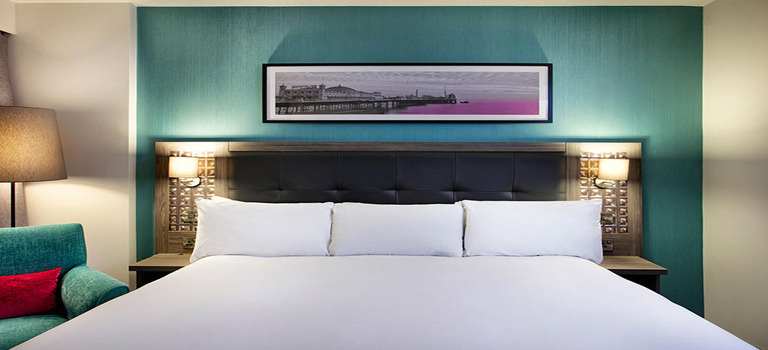 A double bedroom with teal walls