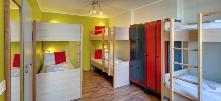 A hostel room in Cologne with several beds