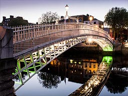 A bridge over the River Liffey, lit up at night