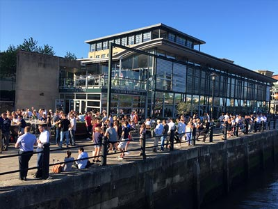Lots of people drinking in the beer garden of Newcastle Quayside