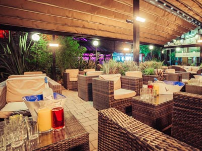 Livello's outdoor terrace at night
