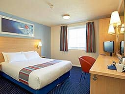A room within Edinburgh's Travelodge with dark blue carpet