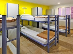 A dorm room with blue bunk beds at the Center Ramblas
