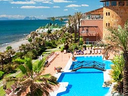 Outdoor pool and exterior or Elba Estepona Gran Hotel & Thalasso Spa, with the coast in the background