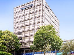 The exterior of Travelodge Nottingham Central with trees outside