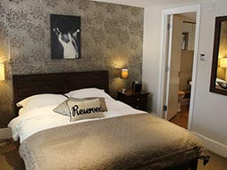 A double room in Upper Rock Apartments with a reserved pillow on the bed
