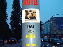 A sign outside Hotel East side mimicking some graffiti on the Berlin Wall