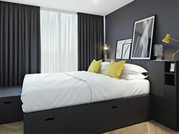 A guest bedroom at Chancery Lane Apartments