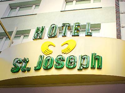 The exterior sign of the St Joseph Hotel