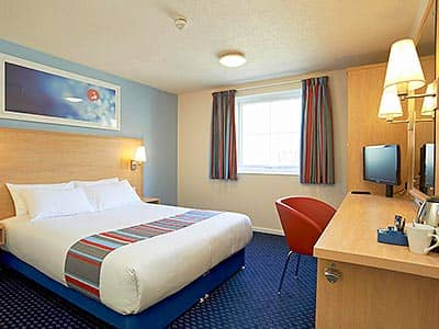 A room within Edinburghs Travelodge with dark blue carpet
