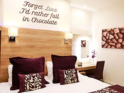 A chocolate themed bedroom in The Chocolate Box Boutique Bed and Breakfast