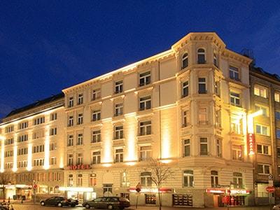 The exterior of Novum Hotel Eleazar City Centre under a clear blue sky