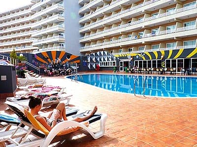 Some people lounging by the pool in Magaluf