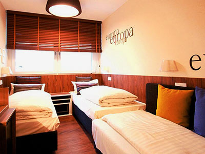 A room with single beds and a window