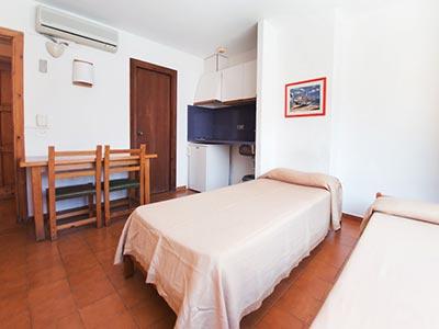 A guest bedroom at Ibiza Rocks Apartments