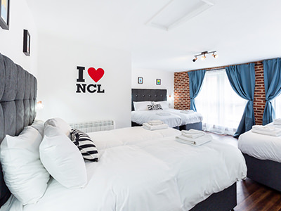 A guest bedroom at The Loft Penthoose in Newcastle