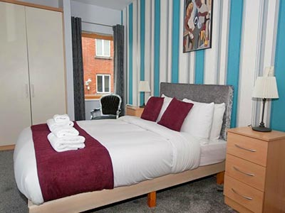 A guest bedroom at Ellis Quay Apartments