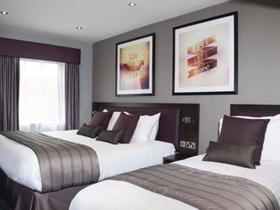 A twin bedroom at Epic Apart Hotel Duke Street