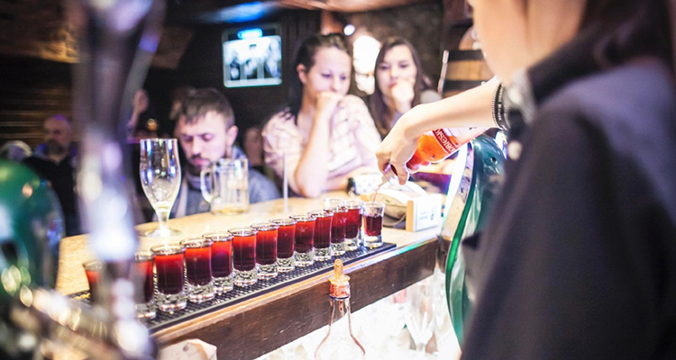 Shots being poured on the bar at Dobry Kumpel Krakow.