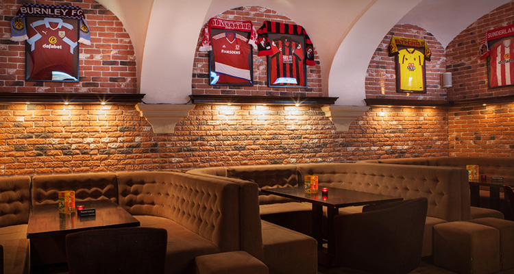 Seating booths at Pub Polski in Krakow.