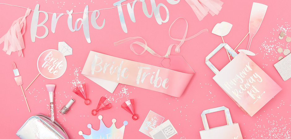 A collection of hen items including sashes, photo booth props and shot glass rings