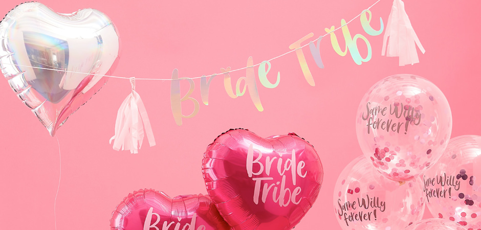 Several balloons in varied shapes with 'bride tribe' written on them