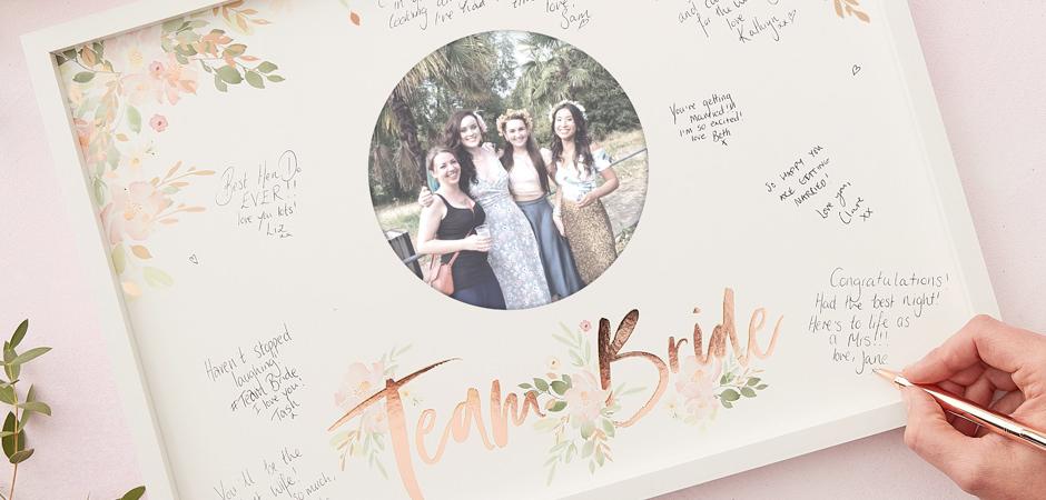 A Team Bride photo frame that has messages written on it