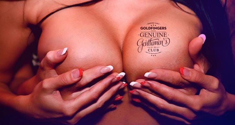 Image of a woman holding her breasts with anothers womens hands on top