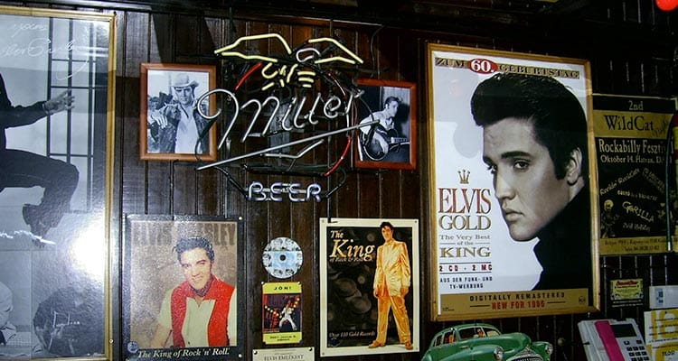 Close up of a wall full of pictures of the king of swing elvis presley