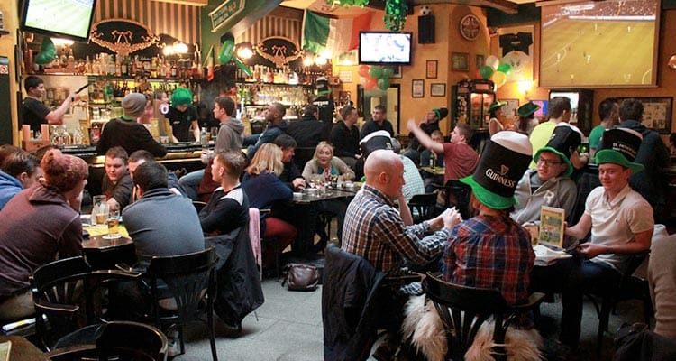 The interiors of Rocky O'Reilly's Irish Pub & Restaurant with lots of men wearing St Paddy's Day hats
