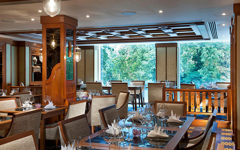Tables and chairs set for dinner at the Lancaster London Hotel restaurant