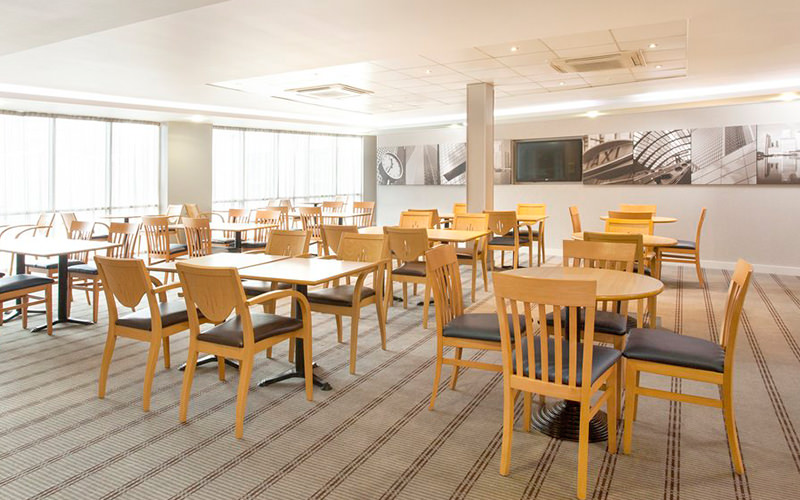Tables and chairs at the restaurant at Holiday Inn Express Limehouse
