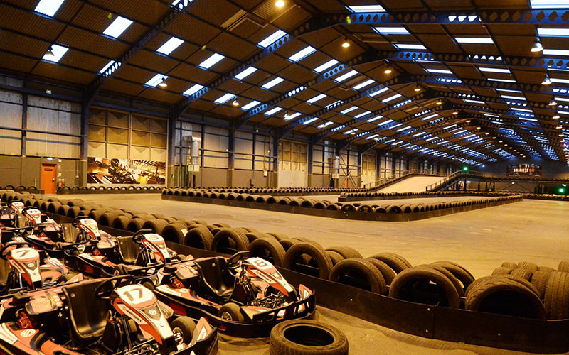Indoor karting arena with used tyres dining the tracks