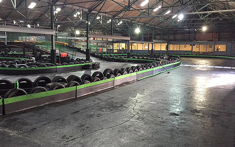 Indoor go karting track, with tyres around the sides, at The Circuit, Liverpool