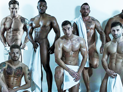 A group of naked men, holding white towels in front of their bodies