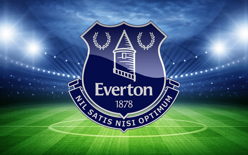 Everton logo in front of a football pitch