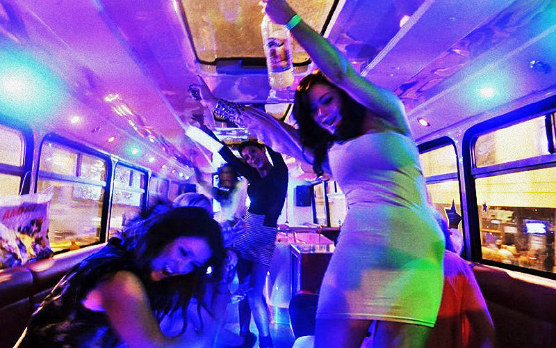 Girls having a wild party aboard the party bus