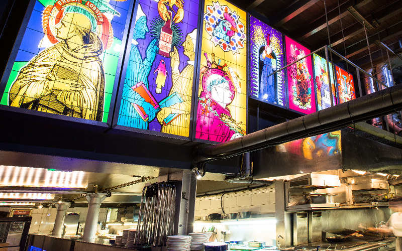 Bright church style panel lights outside of Belgo Centraal, London